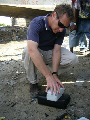 CDC's Tom Handzel collecting water samples for testing to see if household water contains chlorine