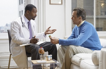 A doctor speaking to a male patient.