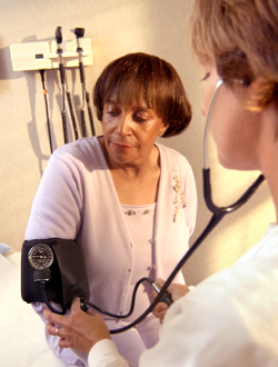 medical professional checking patient's blood pressure