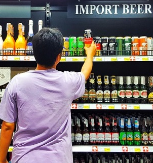man shopping for alcohol