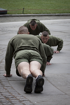 Photo of men in the military doing pushups