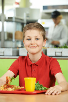 young man at school with healthy lunch