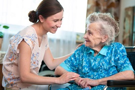 woman sitting and smiling with older woman