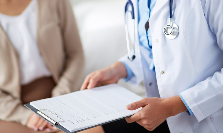 doctor with patient and medical file
