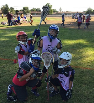 young people outside at lacrosse tournament