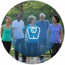 group of adults walking outside and scale icon