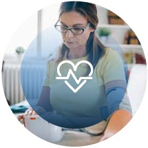 woman checking blood pressure with hear rate icon