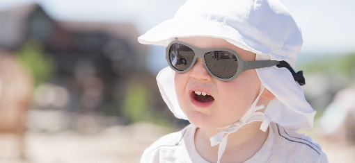 child wearing sunglasses and hat