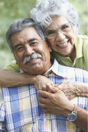 older woman embracing a smiling man