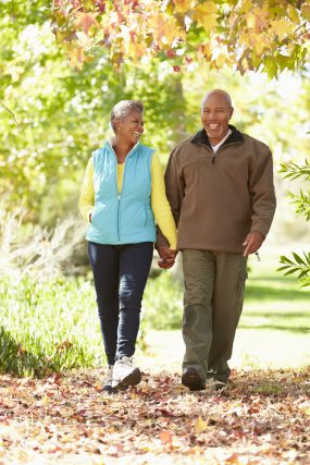 older couple walking in the park