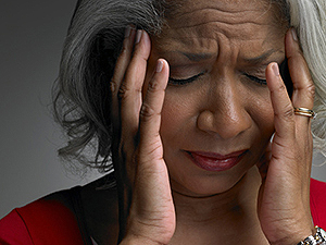 Mature woman with head in hands and eyes closed - Mental Health