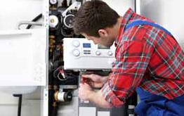 Technician servicing furnace