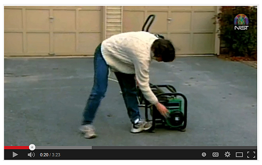 still from video - woman starting outdoor generator