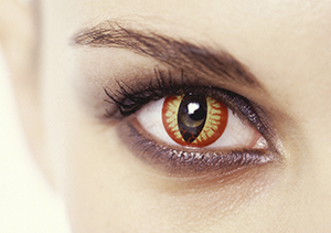 A woman wearing a decorative contact lens that resembles a cats eye