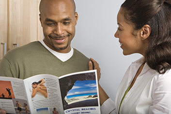 man and woman looking at a brochure