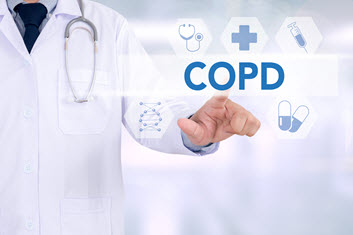 Doctor touching transparent screen that says 'COPD'