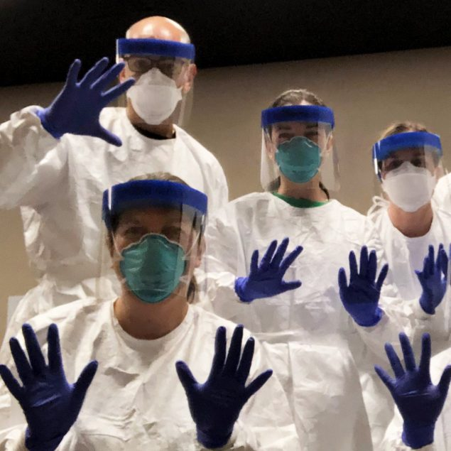 CDC deployers practice in personal protective equipment before going door-to-door to investigate a COVID-19 outbreak in Utah.