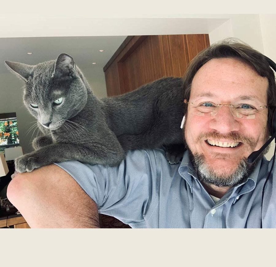Chief Medical Officer for CDC's COVID-19 response John Brooks social distances from home office with his cat, Cosmo.