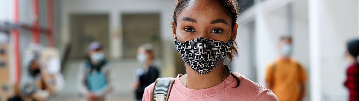 Girl with mask in school hallway