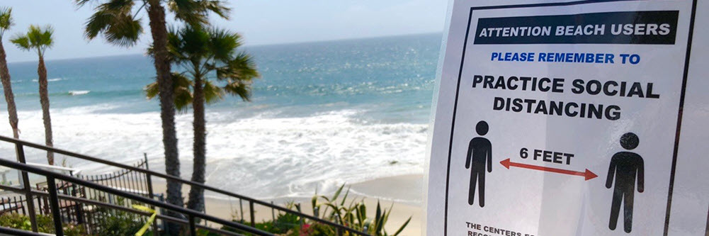 a flyer encouraging social distancing by the beach