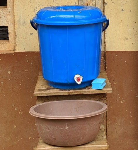 hand washing using a water canister and basin