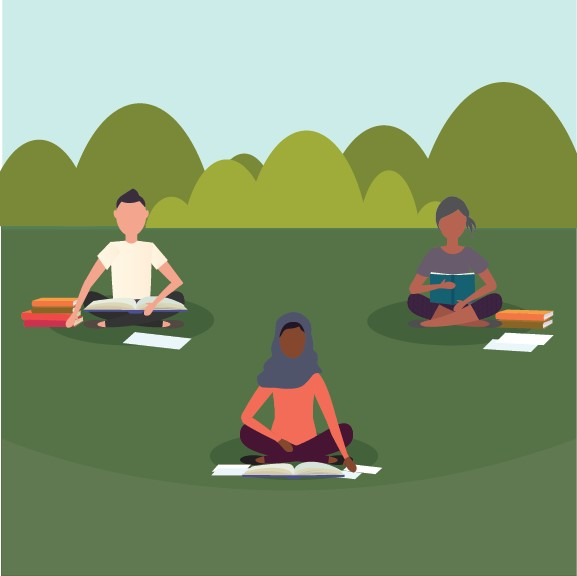 students with open books and papers, sitting on grass and observing social distances