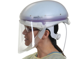 Woman wearing a powered air purifying respirator (PAPR)