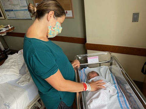 Nurse caring newborn infant