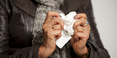 Woman holding a tissue