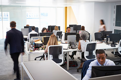 Office floor showing people working at their desks