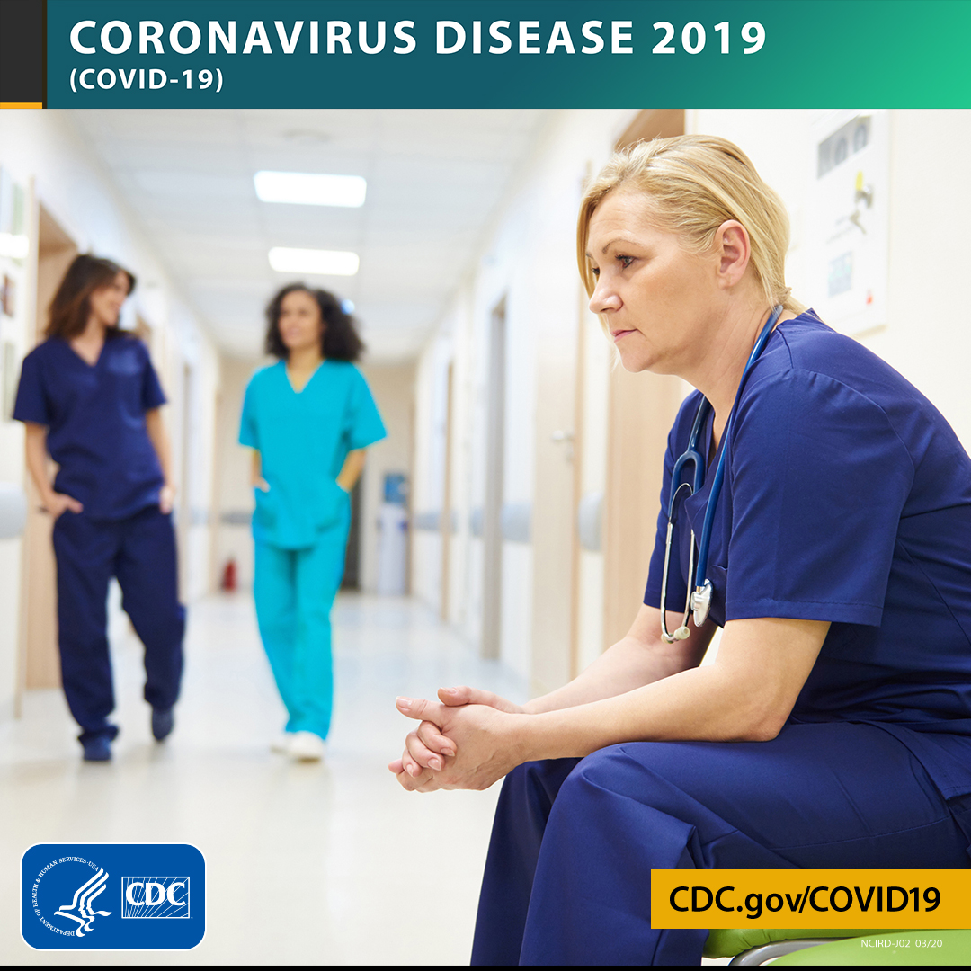 Photo of healthcare workers in a hospital hallway with the text CORONAVIRUS DISEASE 2019 (COVID-19), site URL, and CDC logo.