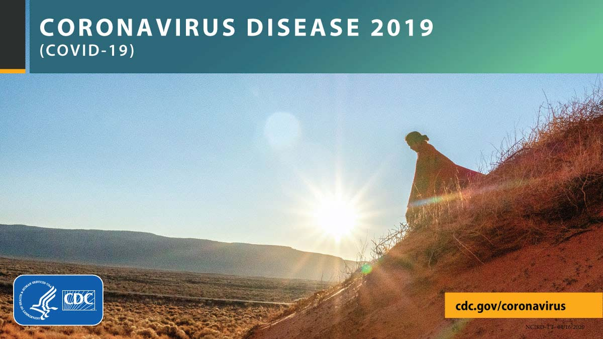 A person walking down a hill in front of sunrise with the text CORONAVIRUS DISEASE 2019 (COVID-19), cdc.gov/covid19, and CDC logo