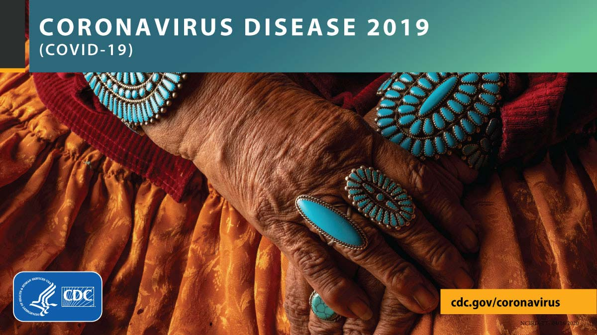 Clasped hands with turquoise jewelry with the text CORONAVIRUS DISEASE 2019 (COVID-19), cdc.gov/covid19, and CDC logo