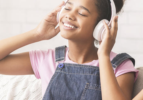 young girl listening to headphones