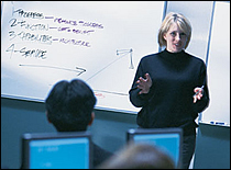 PHPR Training: a woman is talking in front of a group
