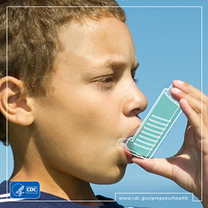 Young boy holding asthma inhaler
