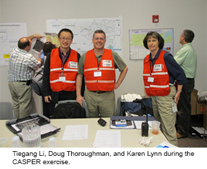 Tiegang Li, Doug Thoroughman, and Karen Lynn during the CASPER exercise