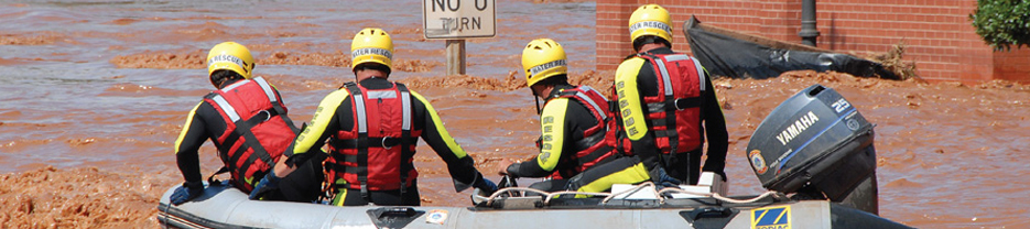 Men in a boat responding to a crisis