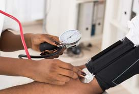 patient having blood pressure tested