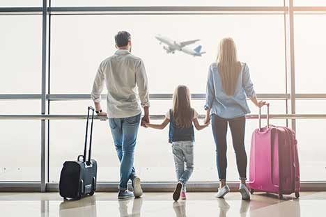 Family waiting for airplane at airport