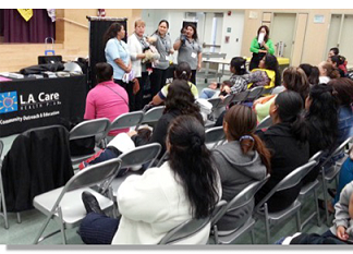 CHWs talking to an audience at an LA event.