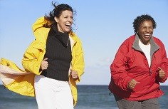 Two women jogging.