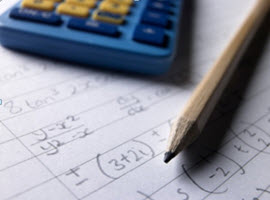 Image of a pencil, paper and calculator on a table
