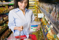 Woman holding basket making food choices