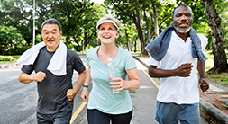 three people jogging