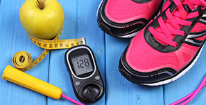 Image of an apple. tape measure, jump rope, pink sneakers and a blood sugar tester