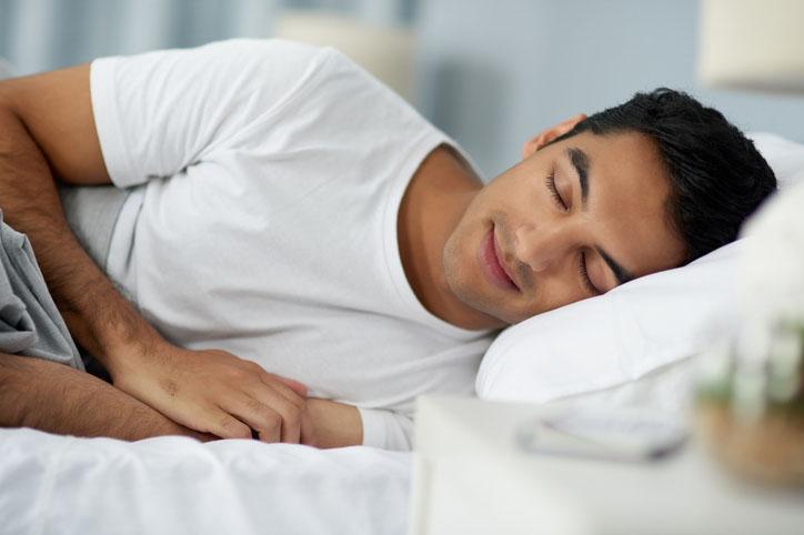 Man in bed, sleeping