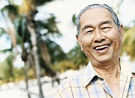 older Asian man smiling