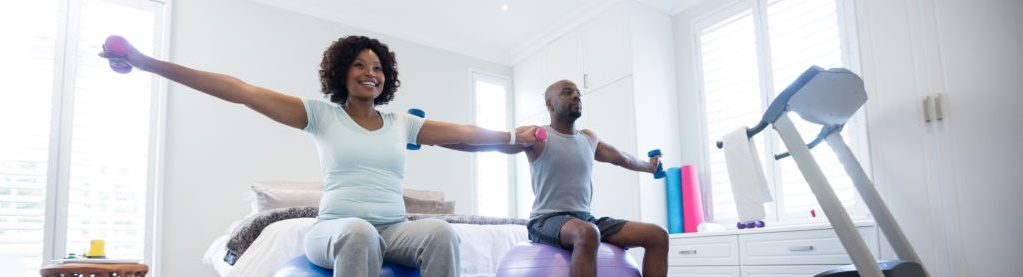 couple working out together at home
