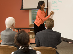 Woman teaching course on white board